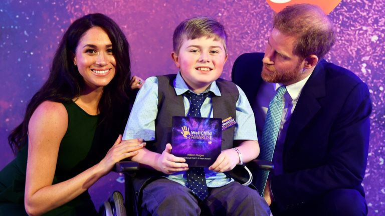 Meghan and Harry with winner William Magee at the 2019 WellChild awards