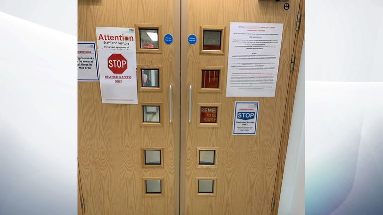 A sign on the door warns the reader they are entering a restricted area