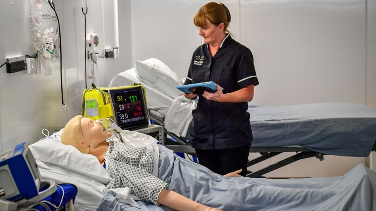 A simulation technician takes part in medical training at the hospital