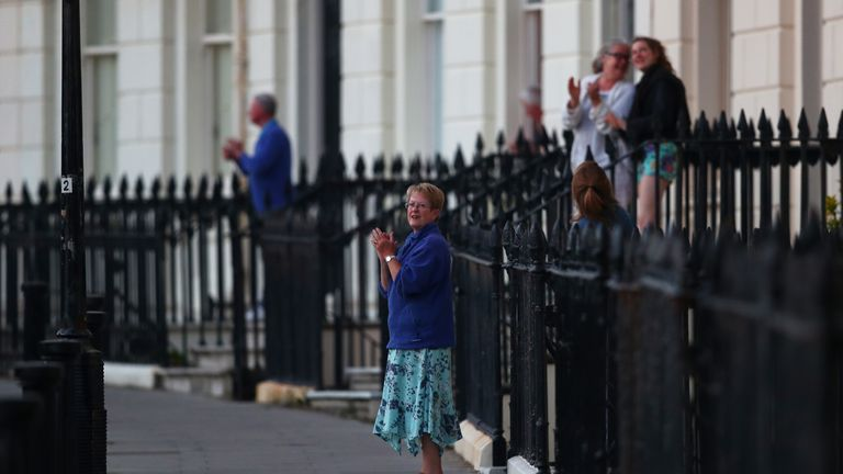 People in Hove stood on their doorsteps to applaud care workers