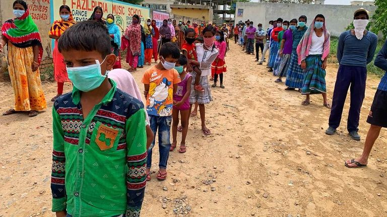Children have been seen waiting in line for food in Gurgaon