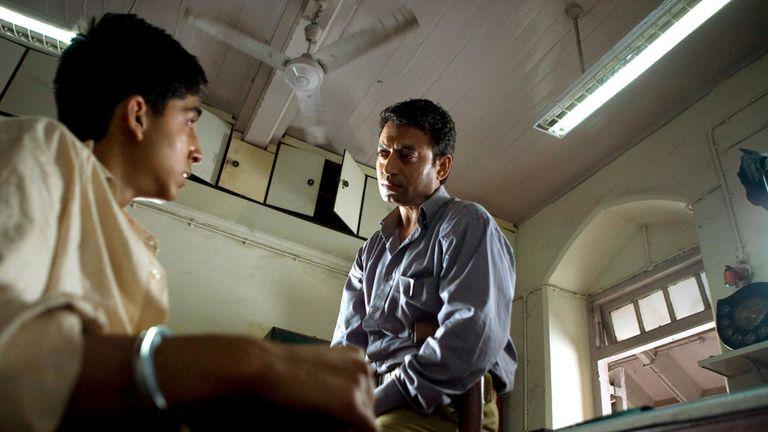 Dev Patel and Irrfan Khan in Slumdog Millionaire. Pic: Celador Films/Pathe International/Kobal/Shutterstock