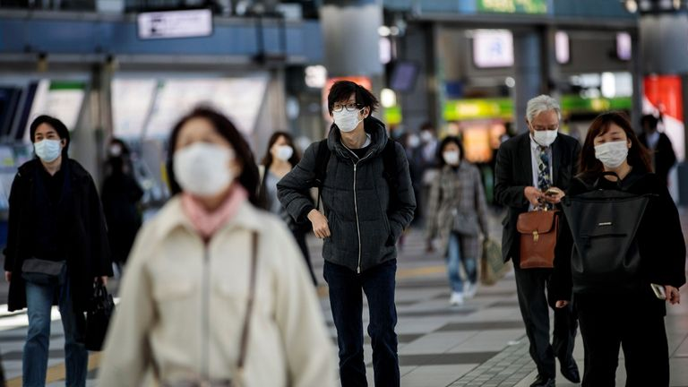 People wearing face masks amid concerns over the spread of the COVID-19 in Tokyo last month