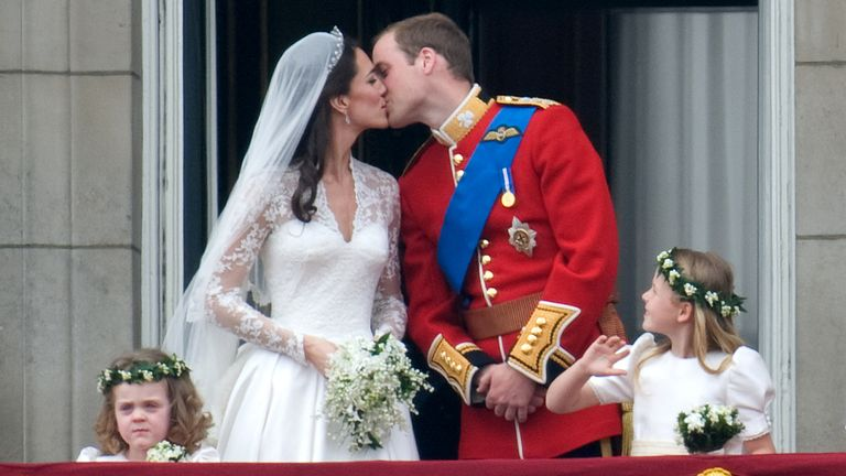 William and Kate kiss on the balcony of Buckingham Palace on their wedding day