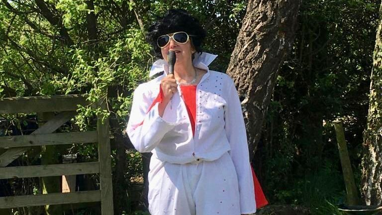 Lynn Hedgecoe is walking six acres 26 times in different outfits. She is pictured here as Elvis