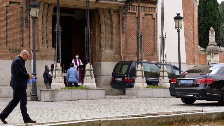 The church in Madrid has a constant cycle of hearses arriving