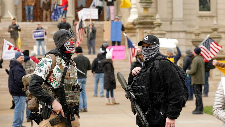 Two heavily-armed protesters in the Michigan capital, Lansing