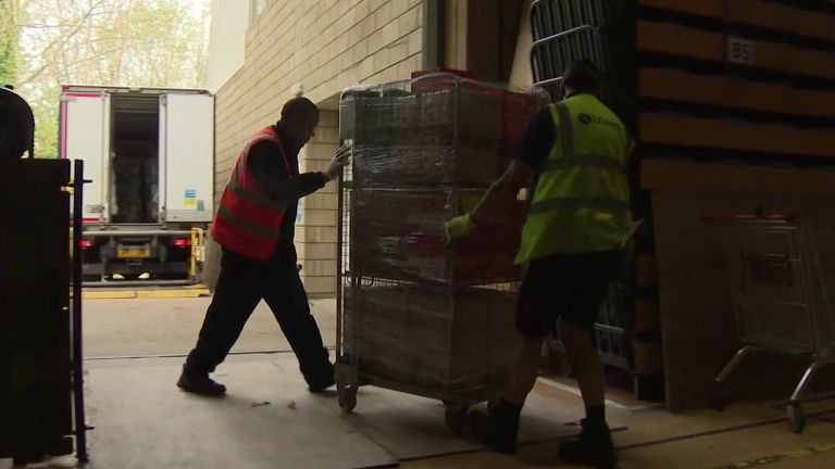 Military veterans take delivery of essential items to be distributed in the community