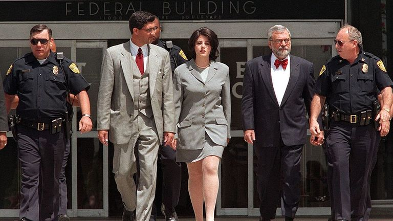 Monica Lewinsky (c) with police officers and her lawyer William Ginsburg in 1998