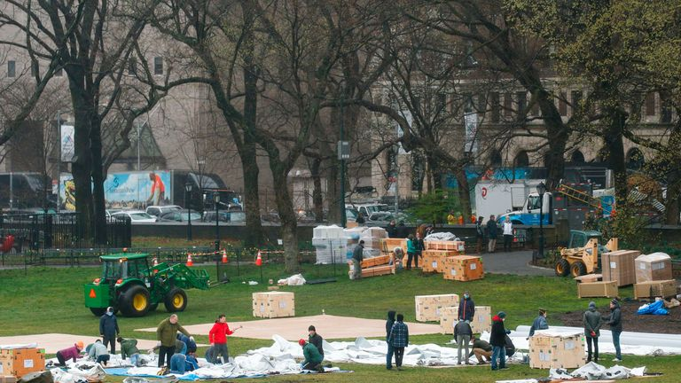 Workers set up a field hospital in front of Mount Sinai West Hospital inside Central Park