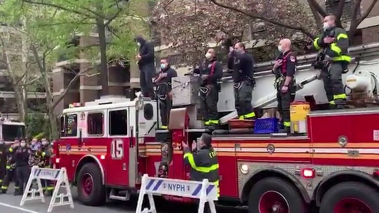 New York Fire Department guitarist plays US national anthem outside hospital