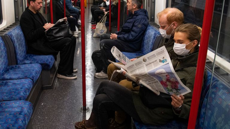 Commuters read newspapers