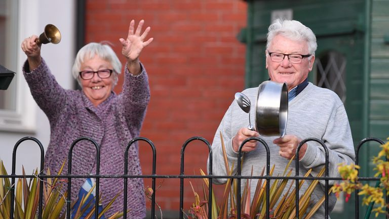 An elderly couple were out with a bell and a saucepan in Penarth, Wales
