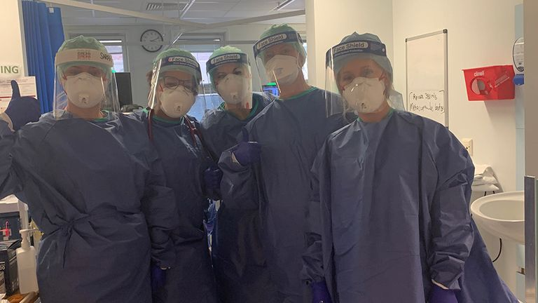 Medical staff wear PPE to treat patients