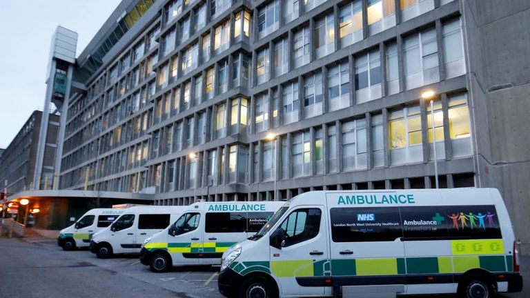 "Ambulances are pictured outside Northwick Park Hospital in London on March 20, 2020, where they have declared a ""critical incident"" due to a surge in patients with covid-19. - Britain's government Friday rolled out a series of extra measures including direct grants to cover wages of employees who have been temporarily furloughed, as it ordered cafes, pubs and restaurants to close entirely. (Photo by Tolga AKMEN / AFP) (Photo by TOLGA AKMEN/AFP via Getty Images)"