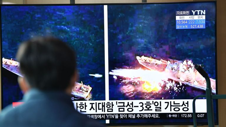 A man in Seoul watches a TV news broadcast showing file footage of a North Korean missile test