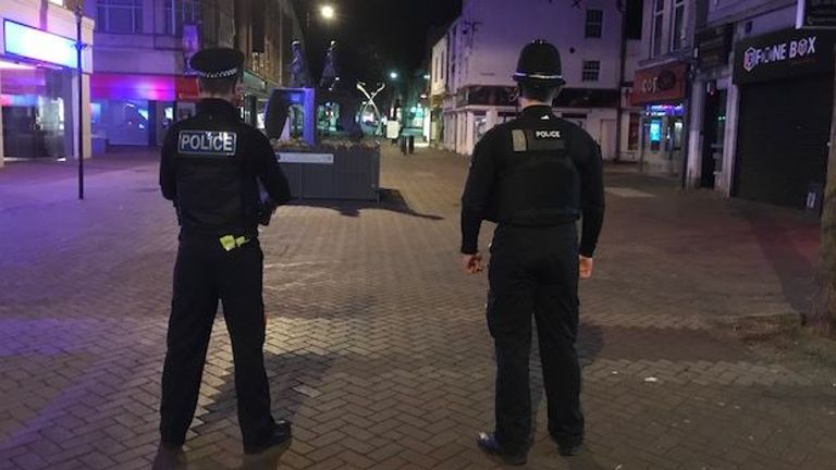 Police on patrol in a deserted Northampton