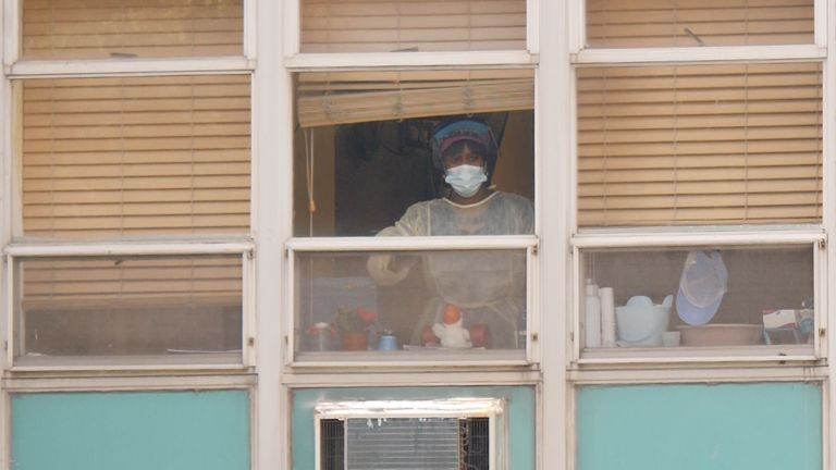 A nurse in the window of a New Jersey care home