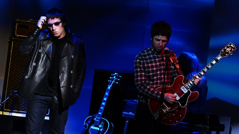 Noel and Liam Gallagher perform together in one of their final shows before Oasis split in 2009