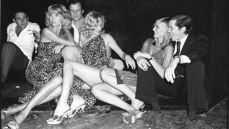 NEW YORK, NY - 1978: Peter Beard and models at Studio 54, c 1978 in New York City. (Photo by Sonia Moskowitz/Getty Images)