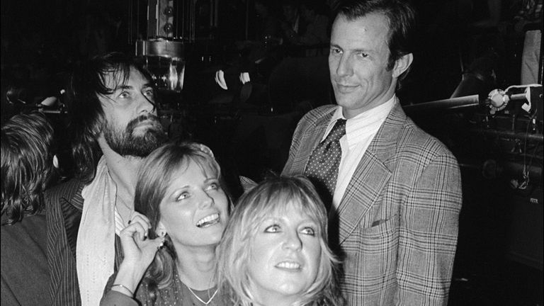 View of British musicians Mick Fleetwood (left) and Christine McVie (second right), both of the group Fleetwood Mac, and American married couple model Cheryl Tiegs (second left) and artist Peter Beard as they visit the DJ booth at Studio 54, New York, New York, November 13, 1979. (Photo by Allan Tannenbaum/Getty Images)