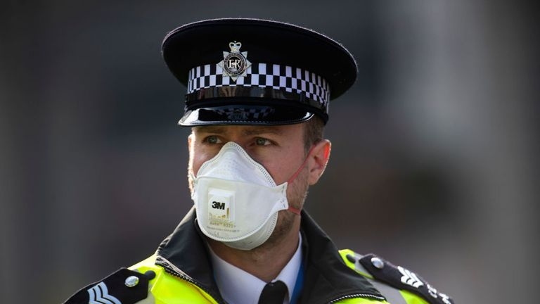 LONDON, ENGLAND - APRIL 09: A police officer in a mask stands guard outside St Thomas' Hospital on April 09, 2020 in London, England. Prime Minister Boris Johnson is still being cared for in the intensive care unit at St Thomas' Hospital after his coronavirus symptoms worsened on Monday night. (Photo by Justin Setterfield/Getty Images)