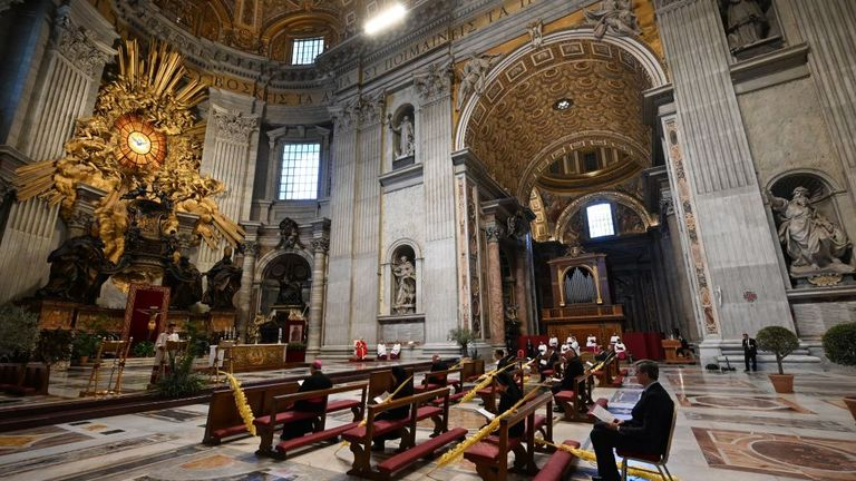VATICAN CITY, VATICAN - APRIL 05: Pope Francis attends the Palm Sunday Mass in an empty Vatican Basilica of St. Peter's due to the Covid-19 coronavirus pandemic, on April 05, 2020 in Vatican City, Vatican. Pope Francis greeted the faithful following his Palm Sunday Mass and Angelus and prayed for the sick and their families, and all those who self-sacrificingly care for them. (Photo by Franco Origlia/Getty Images)