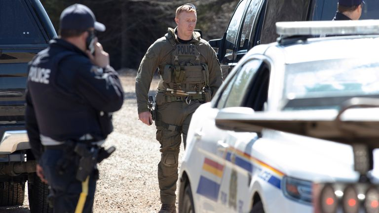 RCMP officers stand on Portapique Beach Road after Gabriel Wortman, a suspected shooter, was taken into custody and was later reported deceased according to local media, in Portapique, Nova Scotia, Canada April 19, 2020