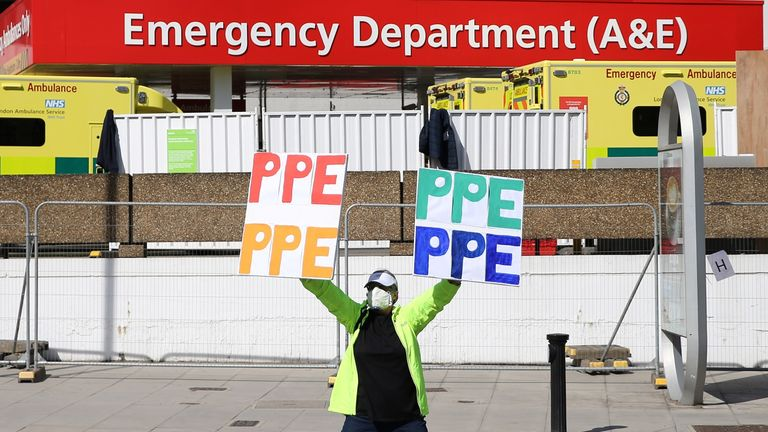 A protester demands more PPE outside St Thomas' Hospital in central London