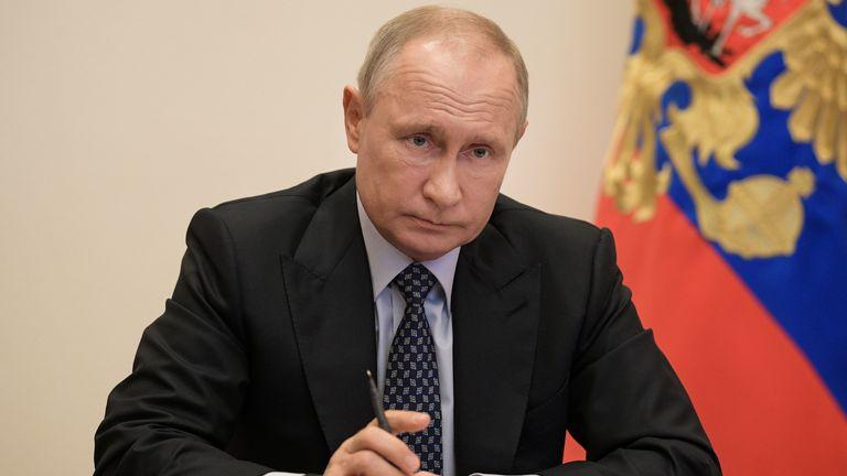 Vladimir Putin chairs a meeting via a video link amid the coronavirus pandemic