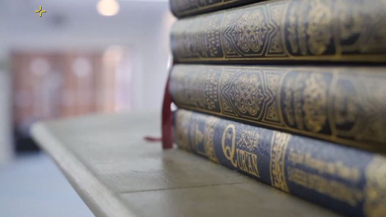 Copies of the Quran are seen stacked inside the Birmingham mosque