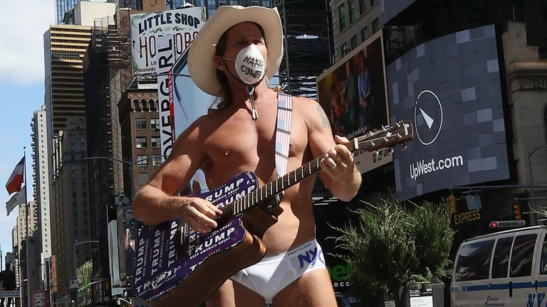 Robert Burck, known as the Naked Cowboy, says he refuses to let the outbreak stop him performing in Times Square
