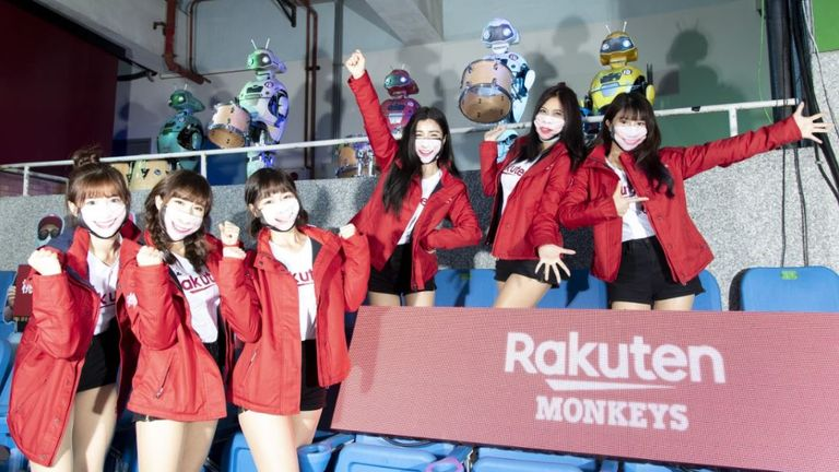 Rakuten Monkeys v CTBC Brothers - CPBL Opening Game TAOYUAN, TAIWAN - APRIL 11: Rakunten girls and the robot cheerleading team poses prior to the CPBL season opening game between Rakuten Monkeys and CTBC Brothers at Taoyuan International Baseball Stadium on April 11, 2020 in Taoyuan, Taiwan. (Photo by Gene Wang/Getty Images)