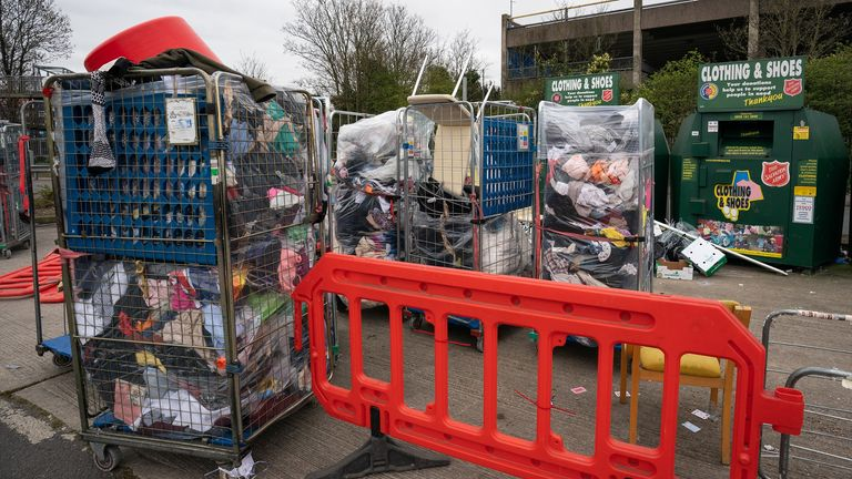 Rubbish piles up outside a Tesco Extra recycling site in Wembley, London