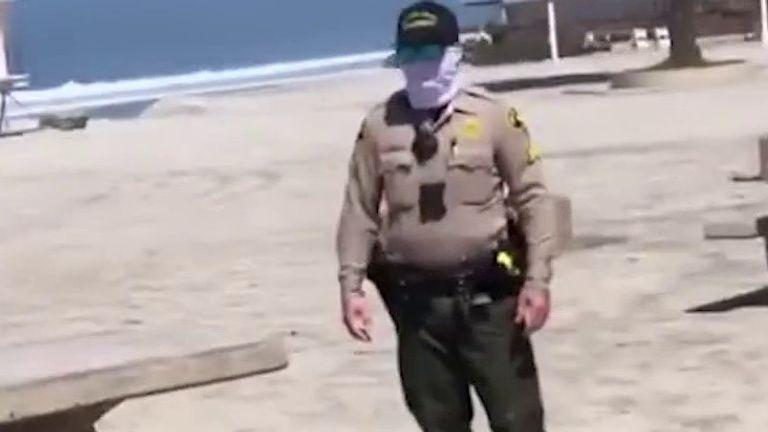 Police arrest people on California beach