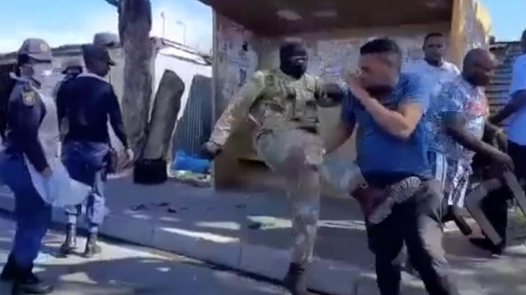 A soldier attacks a man in the street