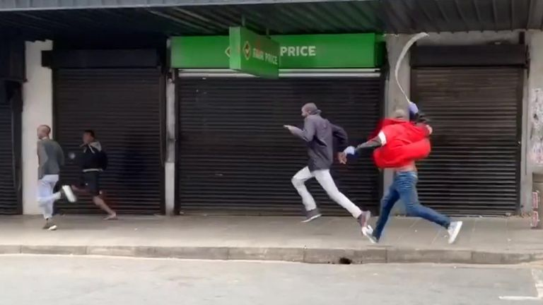 An undercover police officer in Johannesburg was filmed attacking a man with a whip