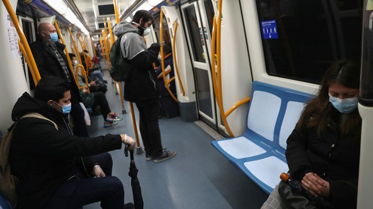Passengers keep social distance as they ride the metro