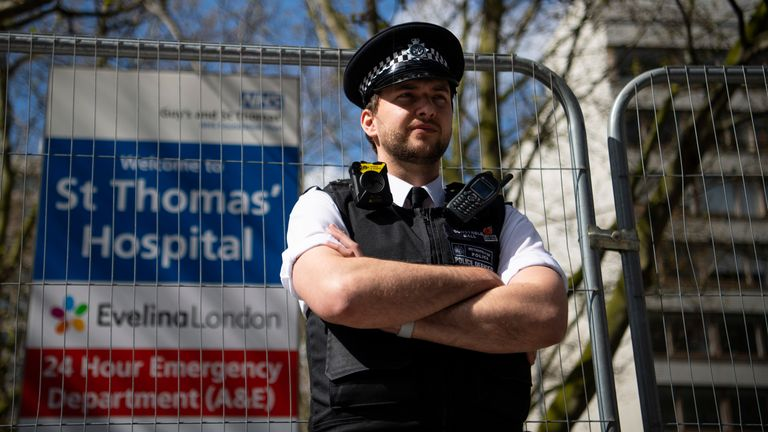 A police officer stands guard outside St Thomas' Hospital