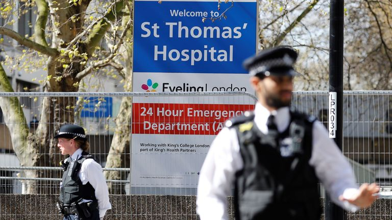 Police stand guard outside St Thomas' Hospital in London, where Boris Johnson is being treated