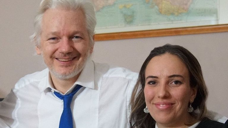 Julian Assange pictured with his partner Stella Morris