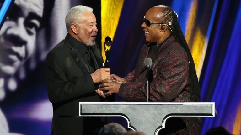 Bill Withers and Stevie Wonder on stage during the 30th Annual Rock And Roll Hall Of Fame Induction Ceremony at Public Hall on April 18, 2015 in Cleveland, Ohio.
