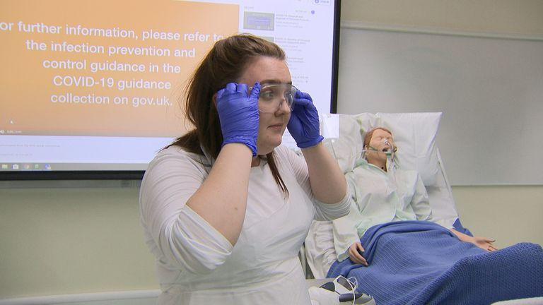 Student nurse Harriet Nadin practices using PPE for COVID-19 reponse