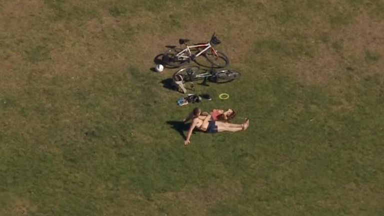 Aerial footage has shown some Londoners sunbathing, despite social distancing advice.