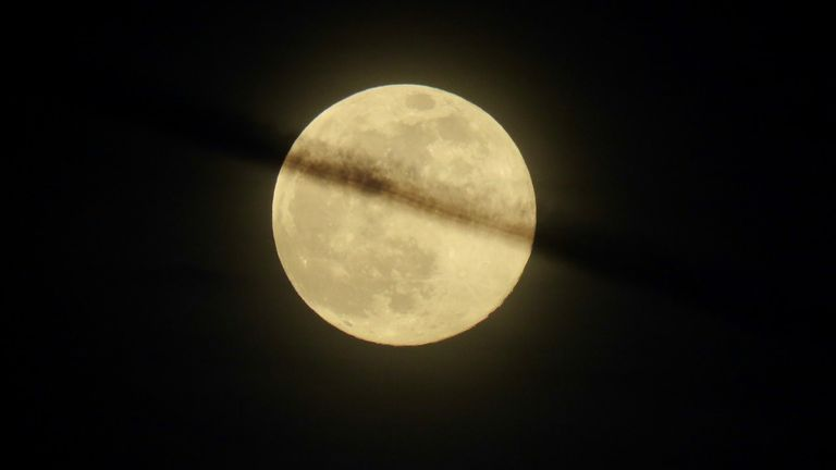 A supermoon is seen on Tuesday night