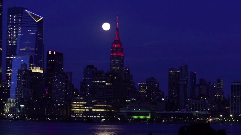 Supermoon moves across New York skyline