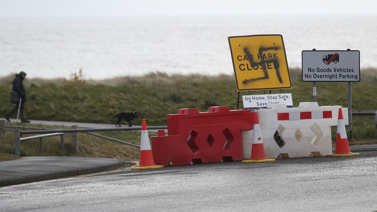 A swastika spray painted on a sign informing the public that car park is closed near the beach at Seaton Sluice, Northumberland. Graffiti has appeared on signs at several car parks along the Northumberland coastal road as the UK continues in lockdown to help curb the spread of the coronavirus. PA Photo. Picture date: Thursday April 30, 2020. See PA story HEALTH Coronavirus. Photo credit should read: Owen Humphreys/PA Wire ..