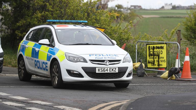 A police car blocks the road where a swastika has been spray painted on a sign at the entrance to a closed road and car park near Whitley Bay lighthouse, Northumberland. Graffiti has appeared on signs at several car parks along the Northumberland coastal road as the UK continues in lockdown to help curb the spread of the coronavirus. PA Photo. Picture date: Thursday April 30, 2020. See PA story HEALTH Coronavirus. Photo credit should read: Owen Humphreys/PA Wire ..