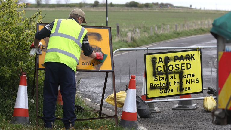 A worker removes a swastika spray painted on a sign at the entrance to a closed road and car park near Whitley Bay lighthouse, Northumberland. Graffiti has appeared on signs at several car parks along the Northumberland coastal road as the UK continues in lockdown to help curb the spread of the coronavirus. PA Photo. Picture date: Thursday April 30, 2020. See PA story HEALTH Coronavirus. Photo credit should read: Owen Humphreys/PA Wire ..