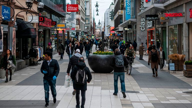 There is no lockdown in Sweden, so people are still visiting shopping streets in Stockholm